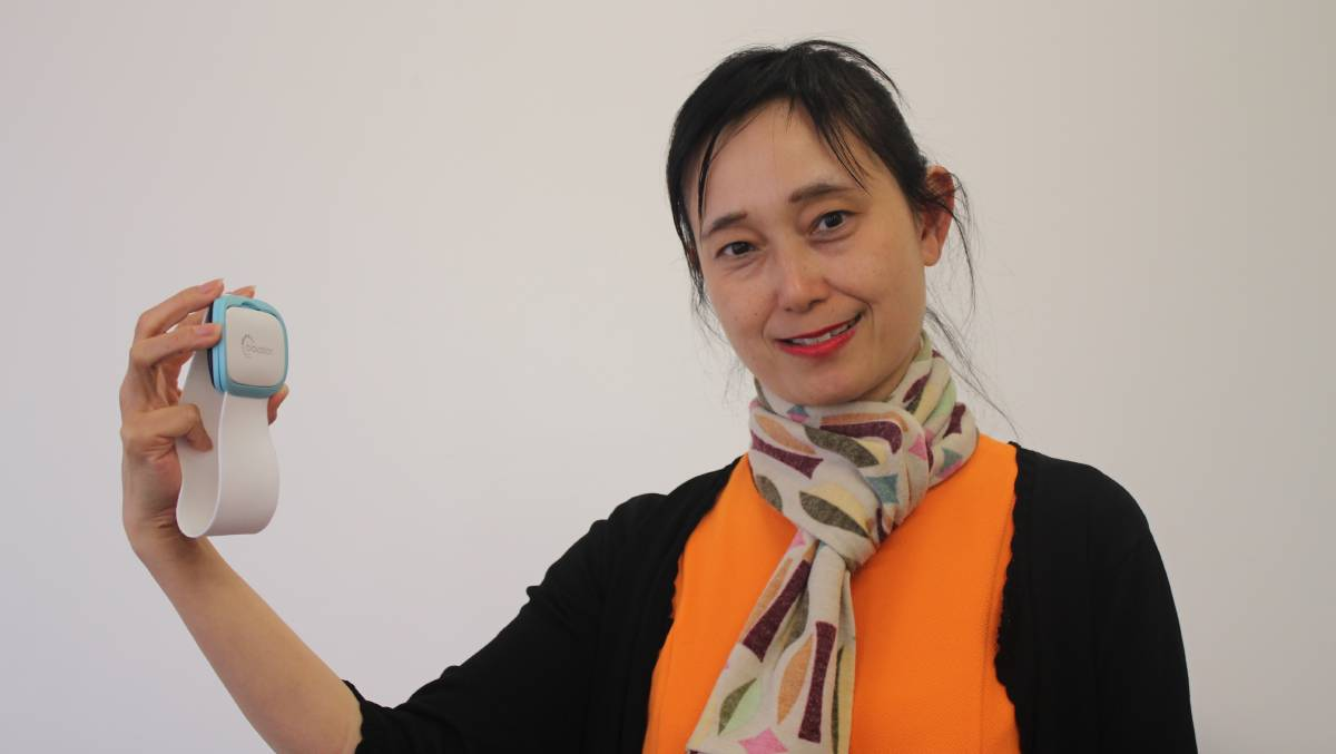Professor Josephine Chow with the armband device.