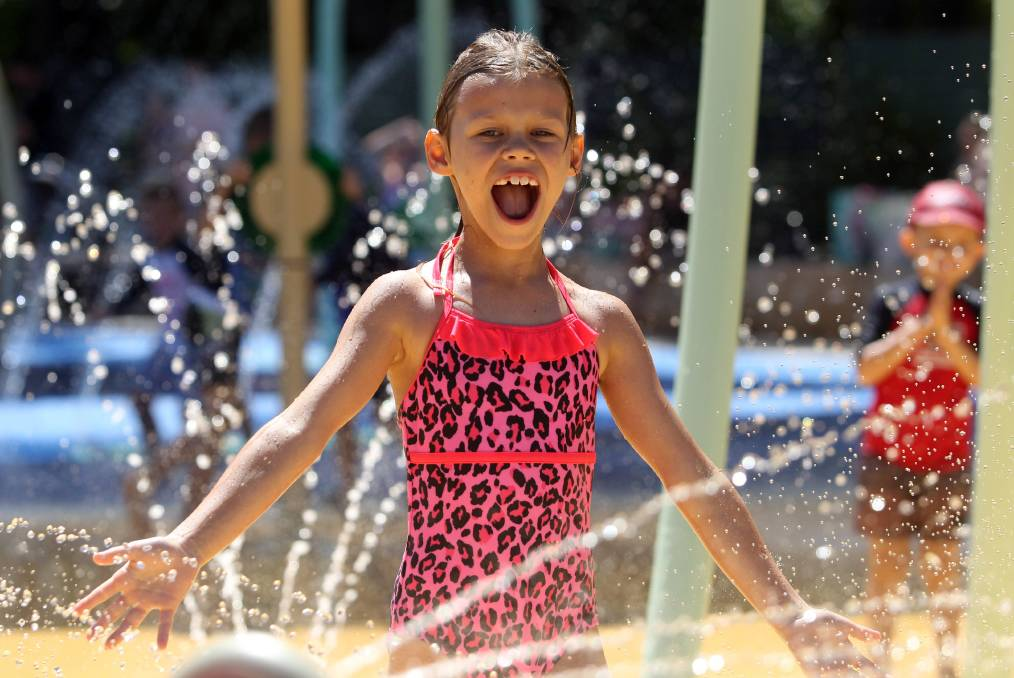 Wet and wild: Children flocked to Elderslie to enjoy the festivities at Curry Reserve's new splash park on Saturday. Picture: Chris Lane