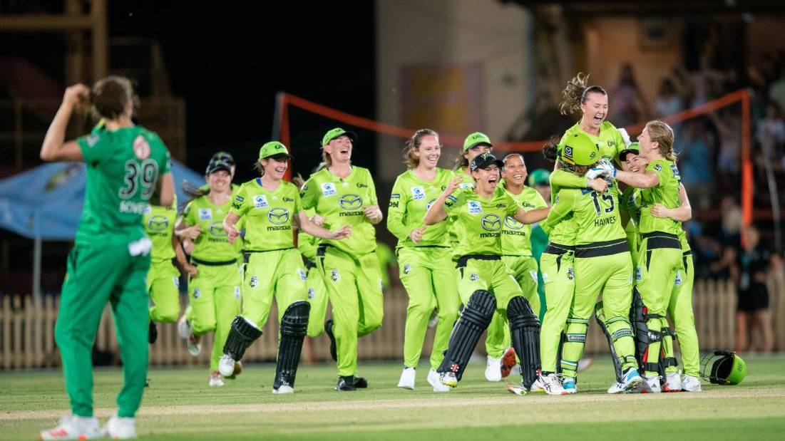 Rachel Trenaman is thrown into the air by teammates as Sydney Thunder celebrate their WBBL final win at North Sydney Oval on Saturday night. Picture: Getty Images