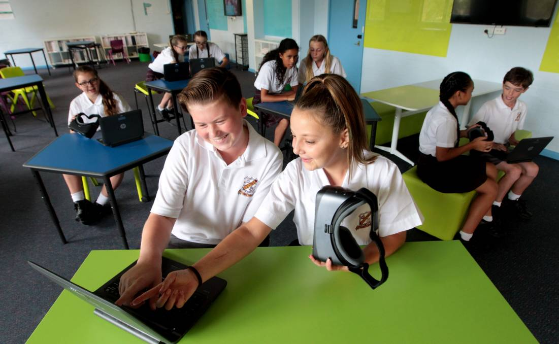 New way of learning: Joshua Doong and Phoebe Roth (front left to right) with other year 7 students in the
