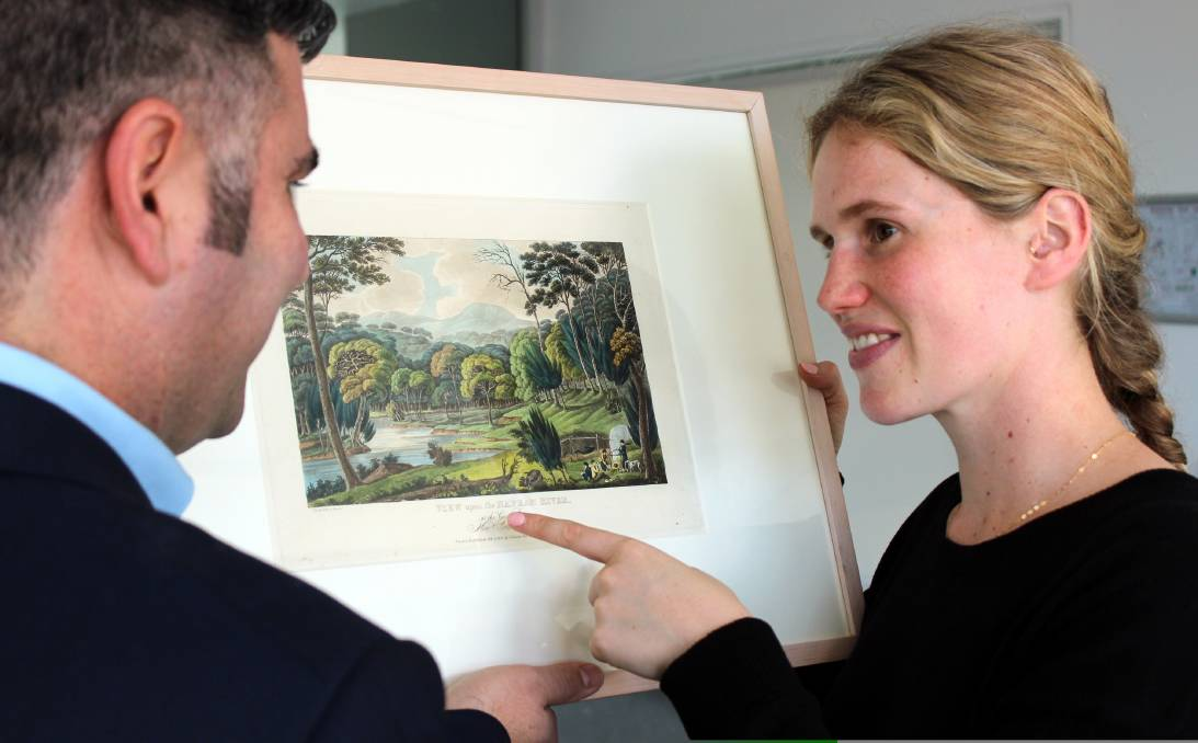 Images from the past: Campbelltown Arts Centre director Michael Dagostino and curator Megan Monte with an 1820s print by Joseph Lycett.